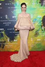 Coco Rocha oozed girly appeal in a dramatic blush-colored off-the-shoulder gown by Zac Posen, featuring loads of ruffly fabric on the bodice, during the Fragrance Foundation Awards.