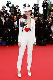 Olga Sorokina chose a deep V-neck jumpsuit with bold embroidered embellishments on the lapel.
