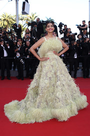 Sonam Kapoor amped up the frill factor in a yellow feather-festooned princess gown by Elie Saab Couture at the 'Inside Out' premiere in Cannes.