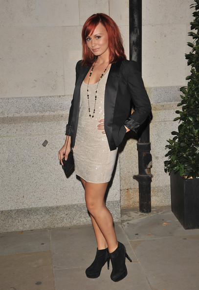 Chanelle Hayes paired her tailored blazer and cocktail dress with suede ankle boots.