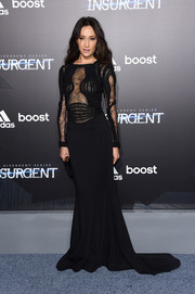 Maggie Q was sexy-goth at the 'Insurgent' premiere in a black Zuhair Murad gown with a sheer lace bodice.