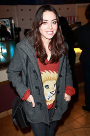 Aubrey Plaza made sure she was warm during the 'Four Stories' film series with this gray tweed jacket and V-neck sweater combo.