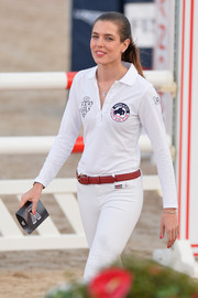 Charlotte Casiraghi styled her white outfit with a red leather belt for the International Monte-Carlo Jumping.