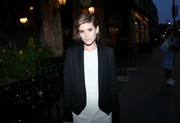 Kate Mara headed to the Dior welcome party wearing a black tux jacket over a white dress.