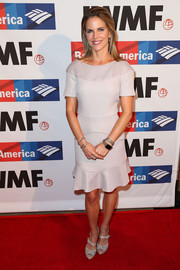 Natalie Morales attended the 2017 Courage in Journalism Awards wearing a short-sleeve taupe dress with a ruffle hem.