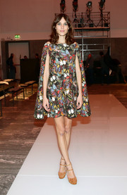 Alexa Chung looked high-fashion mod in this off-the-shoulder cape dress for Milan Fashion Week.