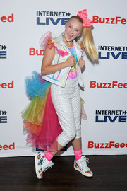 JoJo Siwa completed her ensemble with a pair of embellished high-top sneakers.