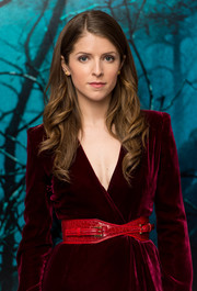 Anna Kendrick wore an oversized red crocodile belt with her wrap dress for a chicer and shapelier finish.