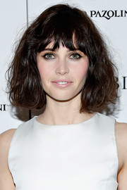 Felicity Jones rocked a mussed-up wavy 'do with choppy bangs at the premiere of 'The Invisible Woman.'
