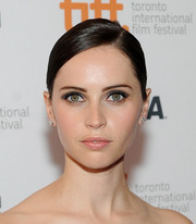 Felicity Jones kept it sleek and classic with this side-parted bun during the premiere of 'The Invisible Woman.'