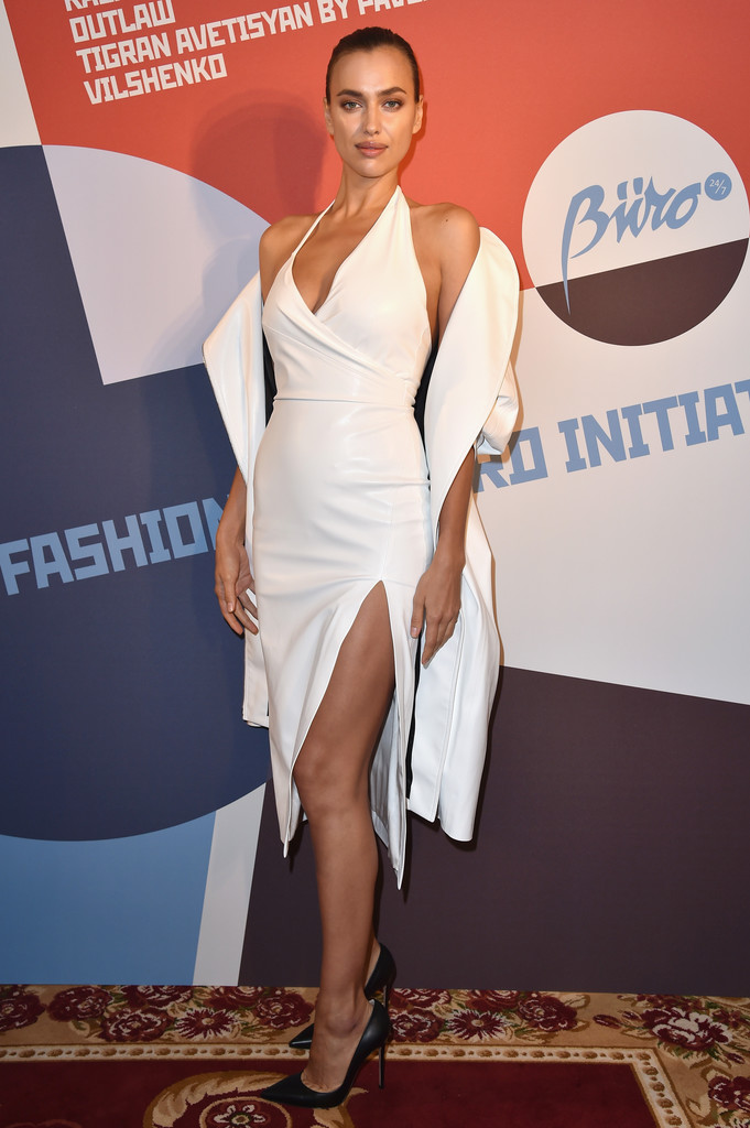 afa370dfb0bf6 Irina Shayk showed off her flawless figure in a fitted white halter dress  at the Buro