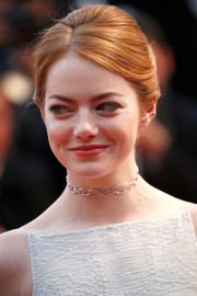 Emma Stone accessorized with a delicate diamond choker by Repossi.