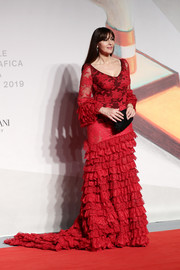 Monica Bellucci got frilled up in a red lace fishtail gown by Dolce & Gabbana for the Venice Film Festival screening of 'Irreversible.'