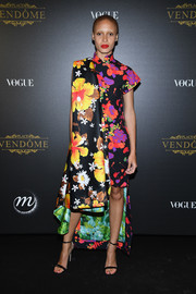 Adwoa Aboah looked exuberant in this multicolored floral dress by Richard Quinn at the Irving Penn exhibition.