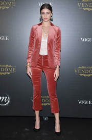 Taylor Hill was sleek and chic in a cropped red velvet suit at the Irving Penn exhibition.