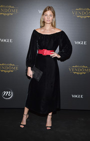Constance Jablonski went for easy elegance in a black off-the-shoulder peasant dress cinched in with a red belt at the Irving Penn exhibition.