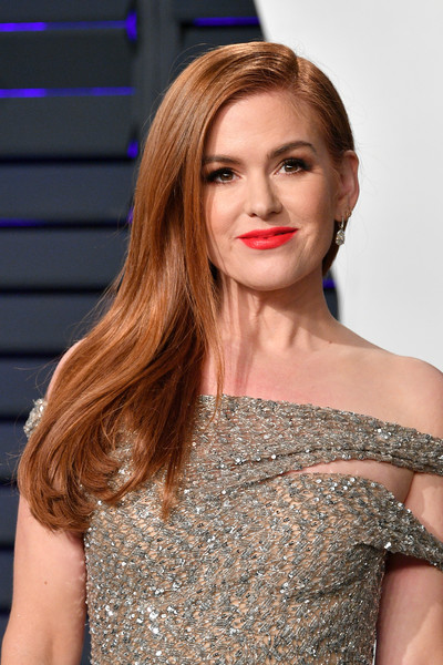 Isla Fisher Side Sweep [oscar party,vanity fair,hair,face,shoulder,hairstyle,lip,beauty,eyebrow,long hair,blond,dress,beverly hills,california,wallis annenberg center for the performing arts,radhika jones - arrivals,radhika jones,isla fisher]