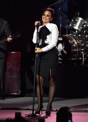 Demi Lovato performed in LA wearing a white blouse with a black pussy bow.