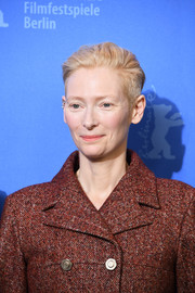 Tilda Swinton attended the Berlinale photocall for 'Isle of Dogs' wearing her hair in a boy cut.