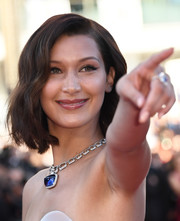 Bella Hadid got majorly blinged up with a huge sapphire pendant by Bulgari.