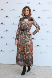 Clotilde Courau looked stylish in an intricately embroidered dress at the 'Italiana. L'Italia Vista Dalla Moda 1971-2001' exhibition preview.