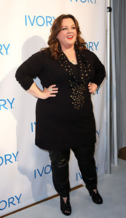 Melissa McCarthy added pep to her step with black studded ankle booties.