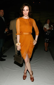 Melissa showed off a sheer drpaed skirt Georgette dress in a soft mustard yellow hue.