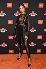 Olivia Culpo smoldered in a black mesh-panel catsuit by Julien Macdonald at JBL Fest 2018.
