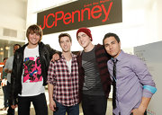 Logan Henderson chose a plaid flannel shirt for his band's performance at JCPenney.