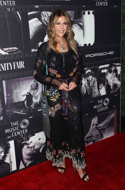 Rita Wilson attended JONI 75: A Birthday Celebration wearing a boho-glam beaded gown.