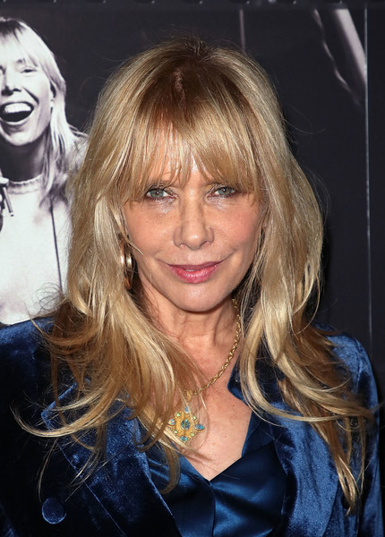 Rosanna Arquette attended JONI 75: A Birthday Celebration wearing a stylish layered cut with eye-grazing bangs.