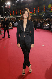 Cobie Smulders was sleek and sophisticated in a dual-textured pantsuit by Versace at the Berlin premiere of 'Jack Reacher: Never Go Back.'