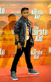 Jaden added some flair to his look with a grey pair of high tops.