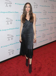 Louise Roe brought a sultry vibe to the Jaguar Concept reveal with this little black slip dress.