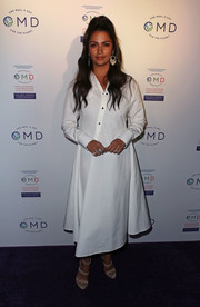 Camila Alves donned a loose white shirtdress for the 'OMD' book launch party.