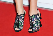 Vanessa Kirby chose a pair of beaded ankle booties with a tiny peep toe for her red carpet look at the Empire Awards.