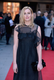 Laura Carmichael went ultra sweet with this bow-adorned velvet clutch and ruffle dress combo at the Jameson Empire Awards.