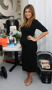 Jamie-Lynn Sigler wore a fitted black maternity dress to her baby shower in NYC.
