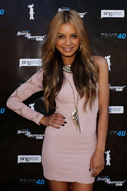 DJ Havana Brown paired her one-sleeve dress with a gold angle wing necklace.
