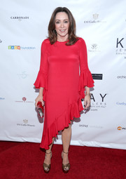 Patricia Heaton donned a red cocktail dress with an asymmetrical hem and ruffle detailing for the 2017 Open Hearts Gala.