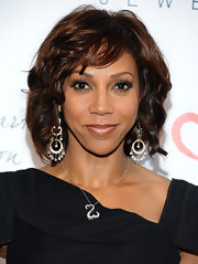 Holly Robinson Peete wore her hair in soft curls and waves with side-swept bangs while attending the second annual Open Hearts Foundation Celebration.