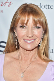 Jane Seymour wore her hair down in a simple straight style with wispy bangs at the 2019 Open Hearts Gala.