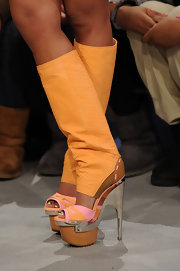 Niki Minaj showed her love of runway fashion in this killer pair of colorful platform boots. Nice to see that someone has put the awesome boots to good use.