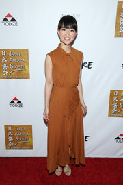Marie Kondo styled her dress with strappy silver sandals.