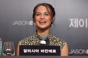 Alicia Vikander attended the 'Jason Bourne' press conference in Seoul wearing her hair in a messy updo.