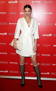 Jessie J styled her wrap dress with sassy black net boots.
