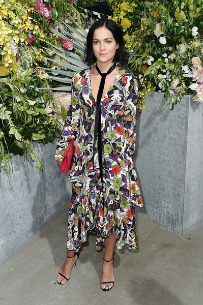 Leigh Lezark looked romantic in a tiered floral dress by Jason Wu during the brand's fashion show.