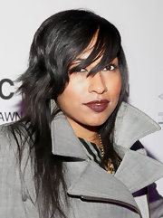 Melanie Fiona wore her hair in a cool cut with lots of razored layers and sexy side-swept bangs at Jay-Z concert benefiting the United Way.