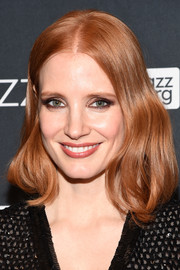 Jessica Chastain styled her hair into an asymmetrical wavy 'do for the Jazz and Broadway event.