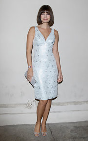 Paulina simply shines in this silver blue brocade cocktail dress. So 50's glam!